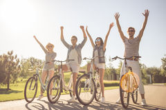 Friends cycling in park Stock Photos