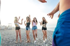 Friends dance on beach under sunset sunlight, having fun, happy, enjoy. Best Friends dancing at beach on sunny day, enjoy, having fun royalty free stock images