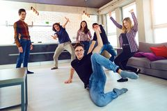 Friends dance at a student`s party in the apartment. Friends dance fun at a student`s party in the apartment Royalty Free Stock Images