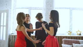 Friends dancing. Cheerful young women dancing and having fun party in bedroom stock video footage