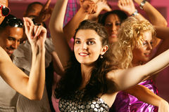 Friends dancing in club or disco Royalty Free Stock Images