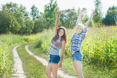 Friends dancing on country road Royalty Free Stock Photos