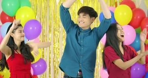 Friends dancing with colorful balloon background at the party in slow motion. stock video footage