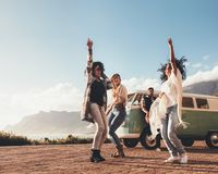 Friends dancing and having fun on road trip. Multi-ethnic friends dancing and having fun on road trip. Group of people enjoying outdoors Royalty Free Stock Photo