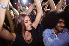 Friends dancing at nightclub. During music festival Royalty Free Stock Images
