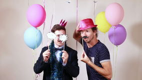 Friends dancing with props in photo booth stock video footage
