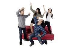 Friends dancing and singing at karaoke Royalty Free Stock Photo