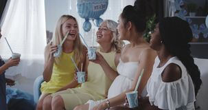 Friends and daughter cheering for young mother. Medium long shot of friends and daughter cheering for young mother stock footage