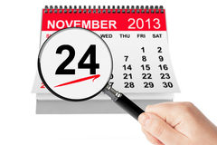 Friends Day Concept. 24 November 2013 calendar with magnifier. On a white background Stock Photography