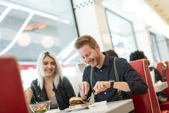 Friends in the diner. Friends eating at the table in the diner Royalty Free Stock Photos