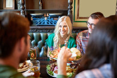 Friends dining and drinking beer at restaurant Stock Images