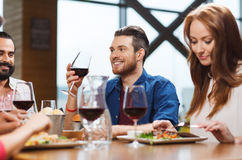Friends dining and drinking wine at restaurant stock photos