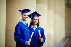 Friends with diplomas Stock Photography