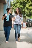 Friends With Disposable Coffee Cups Walking On Stock Photos