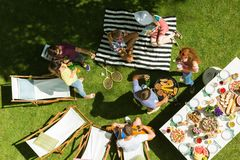 Friends do BBQs stock images