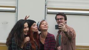 Friends do selfie near the travel trailer stock video footage