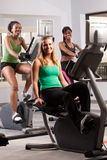Friends doing cardio together. A group of friends on cardio equipment in the gym Stock Photos