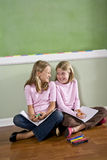 Friends doing homework together Stock Images