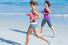 Friends doing jogging together Stock Photos