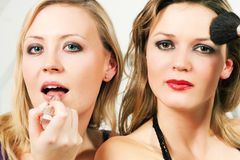 Friends doing make-up Stock Photos