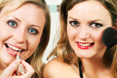 Friends doing make-up Stock Images