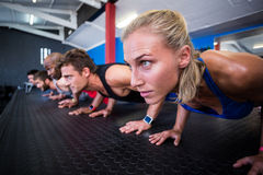 Friends doing push-ups in gym Royalty Free Stock Photo