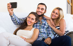 Friends doing selfie at home Stock Image