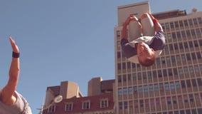 Friends doing somersault stock video