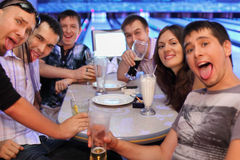 Friends Drink Beer And Cocktails In Bowling Stock Photography