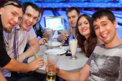 Friends Drink Beer And Cocktails In Bowling Royalty Free Stock Image