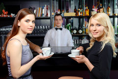 Friends drink coffee at a bar Royalty Free Stock Photo