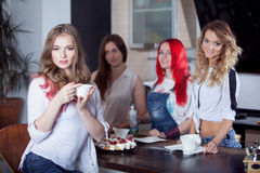 Friends drink tea and coffee at kitchen, portrait Royalty Free Stock Photography