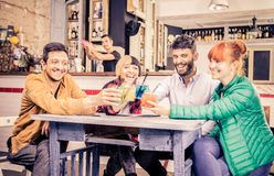 Friends drinking in a bar Stock Image