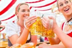Friends drinking Bavarian beer at Oktoberfest royalty free stock photos
