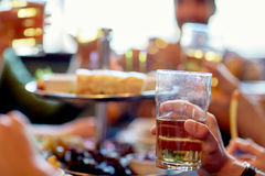 Friends drinking beer at bar or pub. People, leisure and drinks concept - friends drinking beer and at bar or pub Royalty Free Stock Image