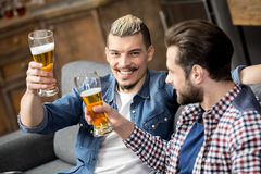 Friends drinking beer. Happy male friends drinking beer Royalty Free Stock Photo