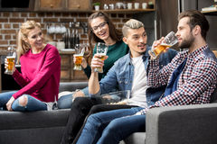 Friends drinking beer. Happy male and female friends drinking beer together Royalty Free Stock Photo