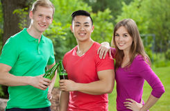 Friends drinking beer in park Royalty Free Stock Image