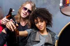 Friends drinking beer after rehearse in studio. Rock and roll band concept Stock Images
