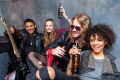 Friends drinking beer after rehearse in studio. Rock and roll band concept Stock Image