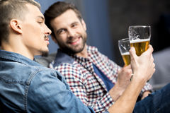 Friends drinking beer. Two young male friends drinking beer Royalty Free Stock Photography