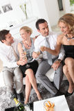 Friends drinking champagne Stock Photos