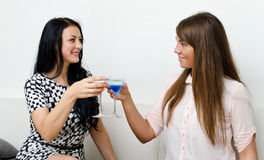 Friends drinking cocktail. Two female friends drinking cocktail Stock Images