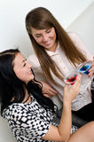 Friends drinking cocktail. Two female friends drinking cocktail Royalty Free Stock Photography