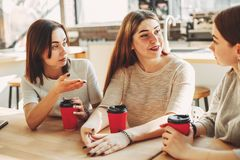 Friends drinking coffee at cafe and talking. People, leisure, co stock images