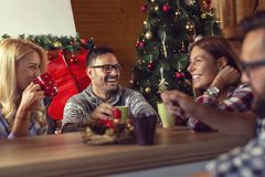 Friends drinking coffee on a Christmas morning royalty free stock photos