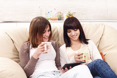 Friends drinking coffee. Fun and Enjoyment Royalty Free Stock Photos