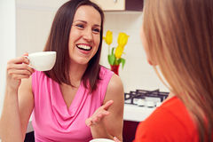 Friends drinking coffee and laughing Royalty Free Stock Photography