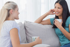 Friends drinking coffee and talking together Royalty Free Stock Photo