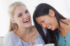 Friends drinking coffee together and laughing Stock Image